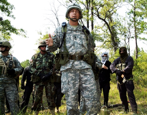 """Army Lt. Col. Mike Kozlik briefs trainees on detecting improvised explosive devices during """"in-lieu-of"""" training at Camp Shelby, Miss. The training incorporates lessons learned from several deployed locations as well as role-playing opposition forces. The colonel is the commander of the 3rd Battalion, 349th Infantry. (U.S. Air Force photo/Herb Welch)"""
