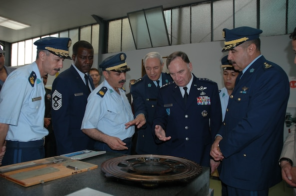 BOUFARIK AIR BASE, Algeria -- General Tom Hobbins, U.S. Air Forces in Europe commander, and Chief Master Sgt. Gary Coleman, U.S. Air Forces in Europe command chief, receive a tour of Boufarik Air Base June 24. During their visit, they toured the transport aircraft maintenance facility, simulator facility and met Airmen from the Algerian Air Force.