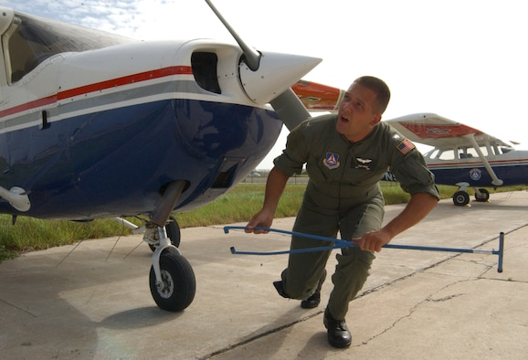 PATRICK AFB, Fla. – Civil Air Patrol 2nd Lt. Todd Wean uses a landing gear attachment to guide a CAP Cessna airplane into position for maintenance here after a security surveillance mission over Cape Canaveral AFS in support of NASA's Return to Flight.
