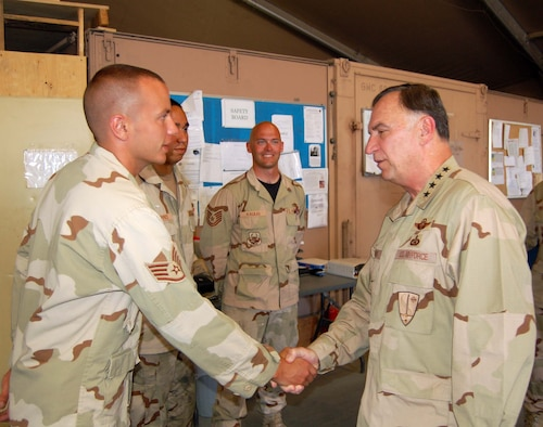 MANAS AIR BASE, Kyrgyzstan-- General Tom Hobbins, USAFE commander greets Staff Sgt. Anthony Allen, 376th Expeditionary Aircraft Maintenance Squadron, during his visit July 5.