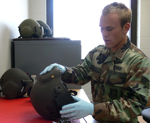 MOODY AIR FORCE BASE, Ga. -- Senior Airman J. Michael Lundell, 41st Rescue Squadron aircrew life support journeyman, looks over a helmet before mounting night-vision goggles to it. Airman Lundell was selected as the Air Force's 2005 Outstanding Life Support Aircrew Airman. (Photo by Senior Airman Ticia Hopkins)