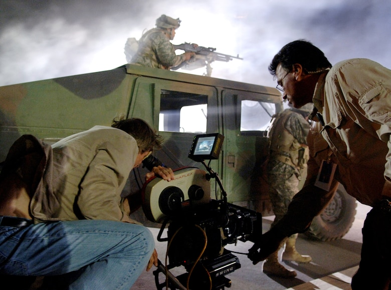 "Movie director Michael Bay films an Airman on the set of the movie ""Transformers"" at Holloman Air Force Base, N.M., on May 31. Several Airmen had the opportunity to fill roles as extras during filming. The movie is scheduled for release in July 2007. (U.S. Air Force photo/Tech. Sgt. Larry A. Simmons)"