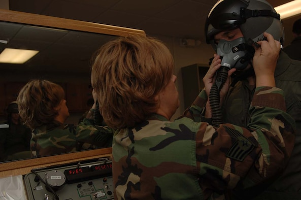MOODY AIR FORCE BASE, Ga. -- Staff Sgt. Rebecca Blalock, 479th Operation Support Squadron here, adjusts a pilot's mask on Cadet Joseph Waechter. Forty cadets are currently touring Moody as part of the Operation Air Force Program. (Photo By Airman 1st Class Schelli Howard)