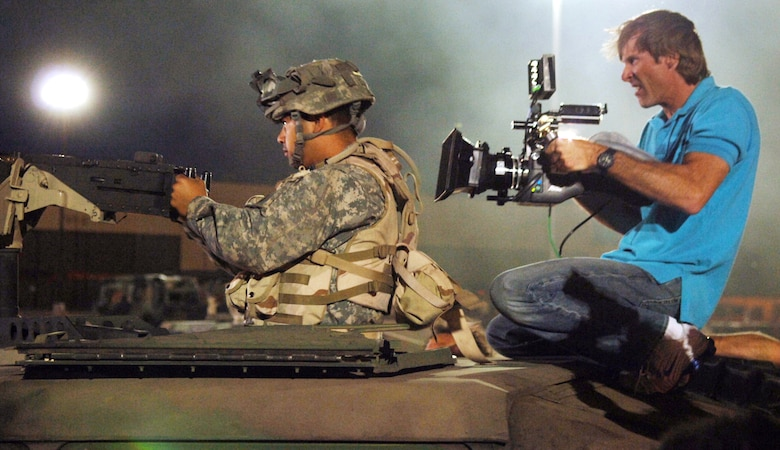 """Movie director Michael Bay films an Airman on the set of the movie """"Transformers"""" at Holloman Air Force Base, N.M., on May 30. Several Airmen filled roles as movie extras. The movie is scheduled for release in July 2007. (U.S. Air Force photo/Tech. Sgt. Larry A. Simmons)"""