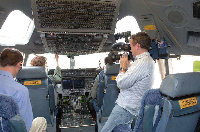 Australian TV Channel 9 reporter and cameraman record Australian aircrew students at the controls of a C-17 at Altus AFB, Okla.