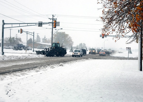 MINOT AFB, N.D. – A 5th Civil Engineer Squadron snowplow clears an intersection here today. Only snow and mission-essential Airmen reported to duty because of the storm. As of 11 a.m., the base had received 5 inches of snow, had winds averaging 45 mph and maintained a temperature of 32 degrees. This is Minot's first snow of the year. (Photo by Staff Sgt. Joe Laws)