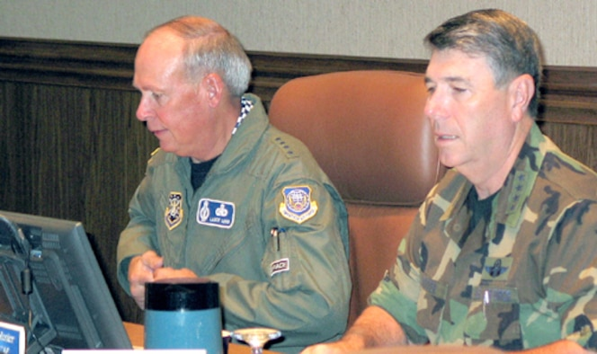 HICKAM AIR FORCE BASE, Hawaii—General Lance W. Lord, Commander, Air Force Space Command, and General Paul V. Hester, Commander, Pacific Air Forces, discuss integration of space and air forces and space support to the Pacific region during the PACAF Commanders Conference Oct. 19. (Photo by Lt. Col. Marcella Adams)