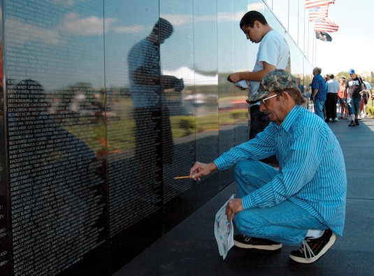 COLORADO SPRINGS, Colo. – Jack Sandstrom (foreground) searches for familiar names at the Vietnam Wall Experience here July 8. The veteran served in 1966 as a member of the 1st Cavalry Division and the 1st Cavalry Air Mobile Division. The memorial, a traveling wall exhibit, visited Memorial Cemetery here through July 11. (photo by Staff Sgt. Don Branum)