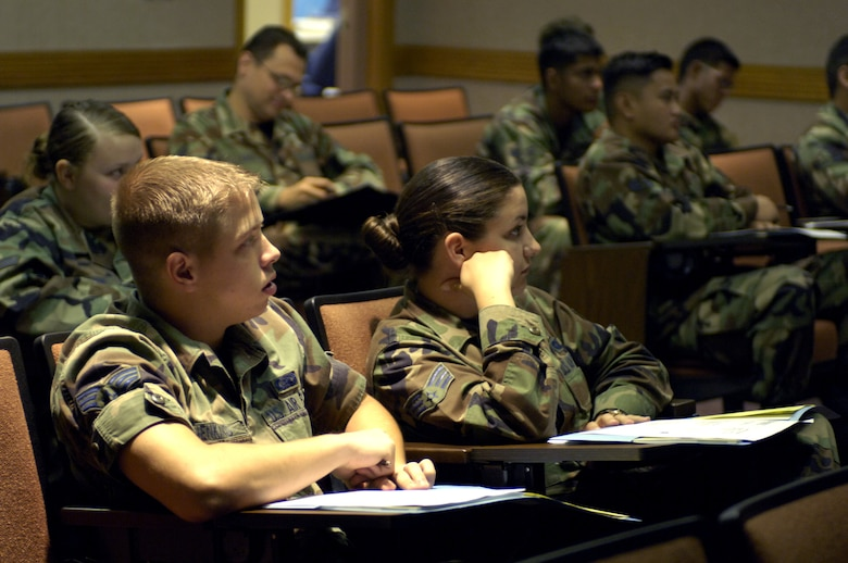 HICKAM AIR FORCE BASE, Hawaii -- Airmen listen to a briefing being held at the Professional Military Education building during an Airman Professional Enhancement Course 11 July 2006 at Hickam Air Force Base, Hawaii. The development course is held once a quarter and targets Airmen who have been in the Air Force for two to four years. The course is meant to fill the gap between the Airman First Term Center and Airman Leadership School. (U.S. Air Force photo/ Tech. Sgt. Shane A. Cuomo)