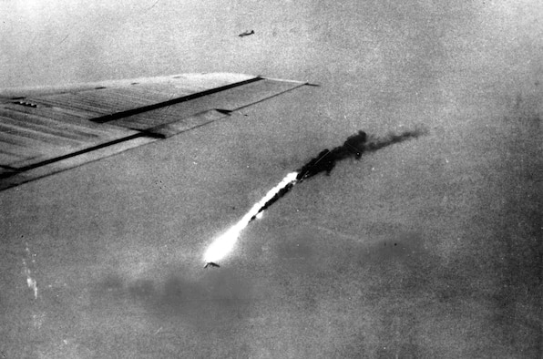 With one wing gone, a B-29 falls in flames after a direct hit by enemy flak over Japan. (U.S. Air Force photo)