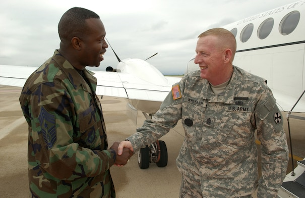 KUNSAN AIR BASE, Republic of Korea -- Sgt. Maj. Barry Wheeler, United States Forces Korea command sergeant major, was greated upon his arrival by the Wolf Pack?s top enlisted member, Command Chief Master Sgt. Reggie ?Wolf Chief? Williams. (Air Force photo by Staff Sgt. Josef Cole)