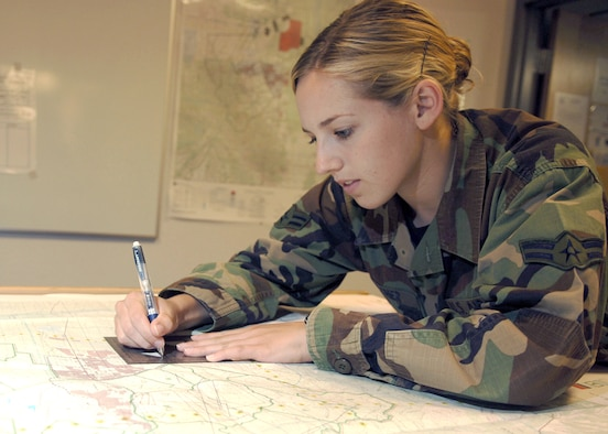 Airman 1st Class Melissa Beecher uses a combat mission plotter to diagram exercise enemy threats on a map at Davis-Monthan Air Force Base, Ariz., on July 10. Airman Beecher is assigned to the 48th Rescue Squadron as an intelligence analyst. (U.S Air Force photo/Senior Airman Christina D. Ponte)