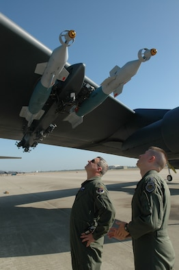 Lt. Col. Al Teauseau, 93rd Bomb Squadron commander, and a fellow captain perform pre-flight checks on the B-52 prior to departure. The LITENING AT targeting pod attached to the other wing, will give commanders in theater the capability to have a precision weapon platform airborne for long periods of time. (U.S. Air Force photo/1st Lt. Torri White)