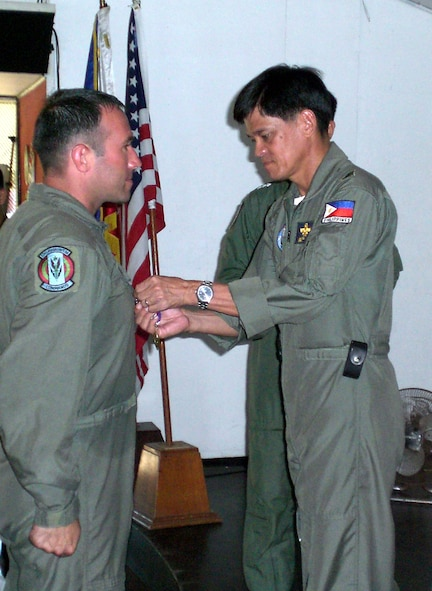 Tech. Sgt. Daniel Weimer, 6th Special Operations Squadron, receives the Philippine Civic Action Medal from Philippine Air Force Brig. Gen. Michael Mendoza, 205th Tactical Helicopter Wing commander. (U.S. Air Force Photograph by Master Sgt. Paul Chick)