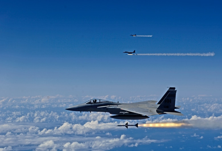 HICKAM AIR FORCE BASE, Hawaii -- F-15 Eagles fire AIM-7 Sparrow missiles at a tactical air-launched decoy July 16, 2006 during Rim of the Pacific Exercise 2006 off the cost of Hawaii. The F-15s are from the Hawaii Air National Guard 199th Fighter Squadron and will be firing 14 live missiles at two decoy targets. RIMPAC 2006 brings friendly forces from the Pacific theater and the United Kingdom together to engage in air and sea war games. (U.S. Air Force photo/ Tech. Sgt. Shane A. Cuomo)