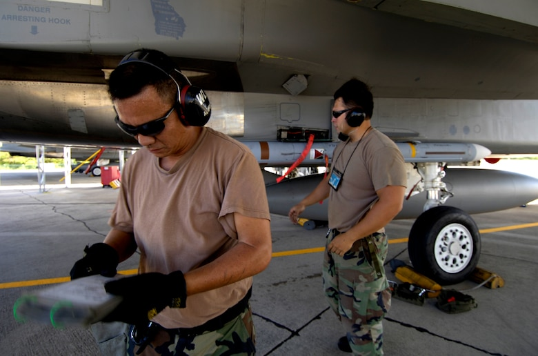 HICKAM AIR FORCE BASE, Hawaii -- Staff Sgt. Arthur Hamabata looks over his checklist after installing an AIM-7 Sparrow missile on F-15 Eagle at Hickam Air Force Base Hawaii July 16, 2006 during Rim of the Pacific Exercise 2006. The Sgt. is from the Hawaii Air National Guard 154th Aircraft Maintenance Squadron. The Eagles will be firing 14 live missiles at two decoy targets during RIMPAC. RIMPAC 2006 brings friendly forces from the Pacific theater and the United Kingdom together to engage in air and sea war games. (U.S. Air Force photo/ Tech. Sgt. Shane A. Cuomo)