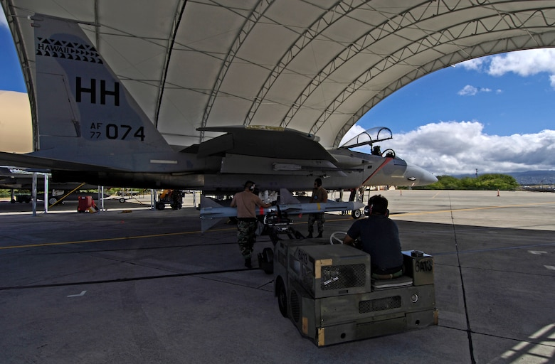 HICKAM AIR FORCE BASE, Hawaii -- Weapons loaders load an AIM-7 Sparrow missile on an F-15 Eagle at Hickam Air Force Base Hawaii July 16, 2006 during Rim of the Pacific Exercise 2006. The Airmen are from the Hawaii Air National Guard 154th Aircraft Maintenance Squadron. The Eagles will be firing 14 live missiles at two decoy targets during RIMPAC. RIMPAC 2006 brings friendly forces from the Pacific theater and the United Kingdom together to engage in air and sea war games. (U.S. Air Force photo/ Tech. Sgt. Shane A. Cuomo)
