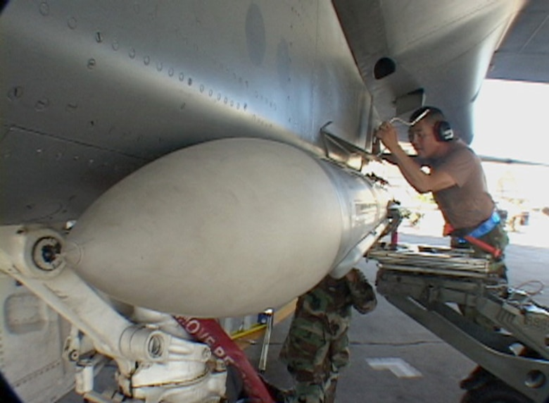 HICKAM AIR FORCE BASE, Hawaii -- Hawaii Air National Guard Airmen attach an AIM-7 missile to an F-15 at Hickam AFB, Hawaii on July 16, 2006.  (US Air Force photo by Tech. Sgt. Chris Vadnais)