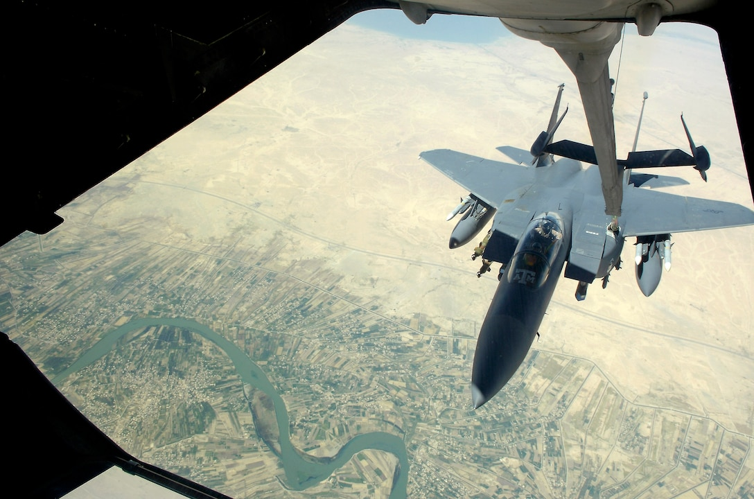 An F-15E Strike Eagle gets fuel from a KC-10 Extender over Baghdad, Iraq, on July 18. The F-15 was flying a close-air-support mission in support of Operation Iraqi Freedom. The KC-10 is with the 908th Expeditionary Air Refueling Squadron in Southwest Asia. (U.S. Air Force photo/Senior Airman Brian Ferguson)