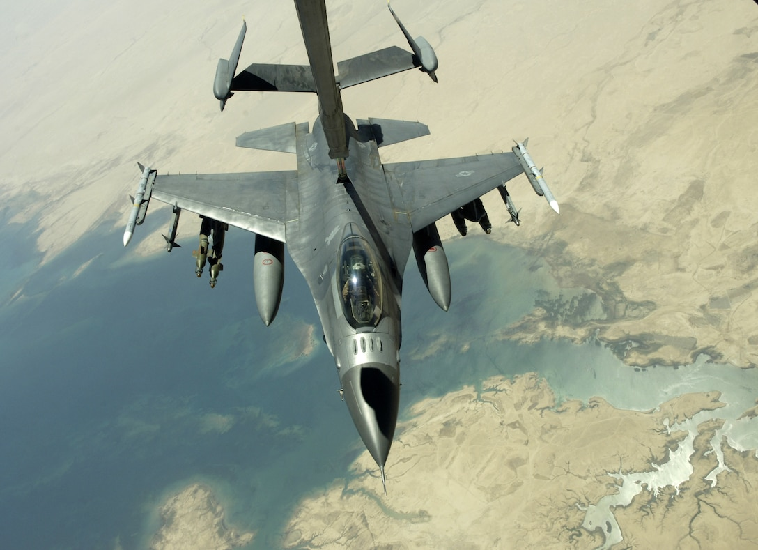 An F-16 Fighting Falcon refuels from a KC-10 Extender while flying a close-air-support mission over Iraq in support of Operation Iraqi Freedom on July 18. The KC-10 is with the 908th Expeditionary Air Refueling Squadron in Southwest Asia. (U.S. Air Force photo/Senior Airman Brian Ferguson)
