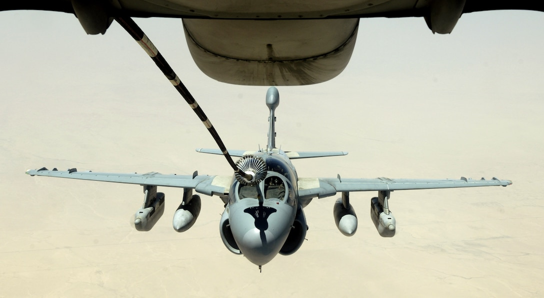 An EA-6 Prowler refuels from the drogue of a KC-10 Extender on July 18. The KC-10 is with the 908th Expeditionary Air Refueling Squadron in Southwest Asia. (U.S. Air Force photo/Senior Airman Brian Ferguson)