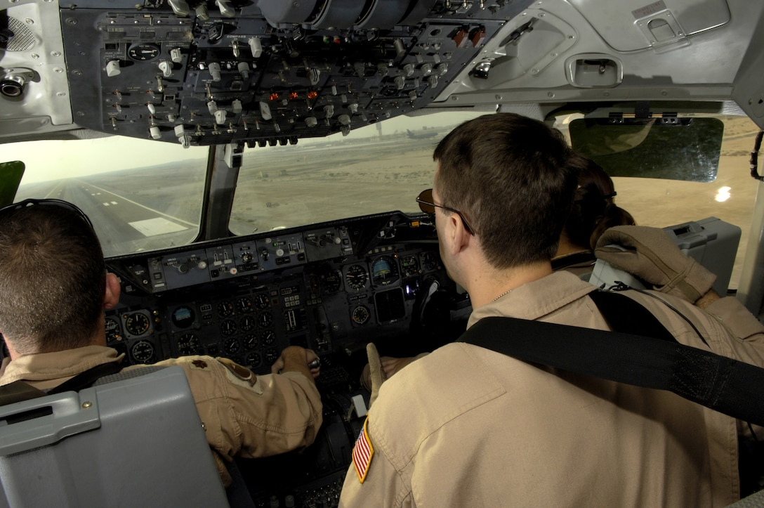 (From left) Maj. James Greathouse, Tech. Sgt. Chris Berry and 1st Lt. Nicole Foster land in a KC-10 Extender on a runway in Southwest Asia after an Operation Iraqi Freedom mission on July 18. The Airmen are with the 908th Expeditionary Air Refueling Squadron. (U.S. Air Force photo/Senior Airman Brian Ferguson)