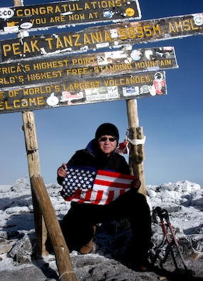 TANZANIA, Africa -- Airman 1st Class Ryan Hockertlotz, a member of Westover Air Reserve Base's 42nd Aerial Port Squadron, crouches on the summit of Mount Kilimanjaro, the world's tallest free-standing mountain. The young porter used only Air Force physical fitness training to prepare for the six-day climb to the top. (Courtesy photo)