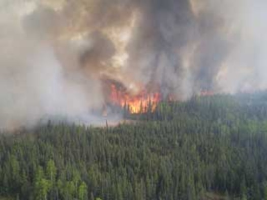 The Parks Highway fire, Alaska, advances as seen from a helicopter on June 8.  The fire has burned more than 114,000 acres of land so far including, two houses, two cabins and several outbuildings. (Photo by Adam Kohley, Alaska Fire Service)