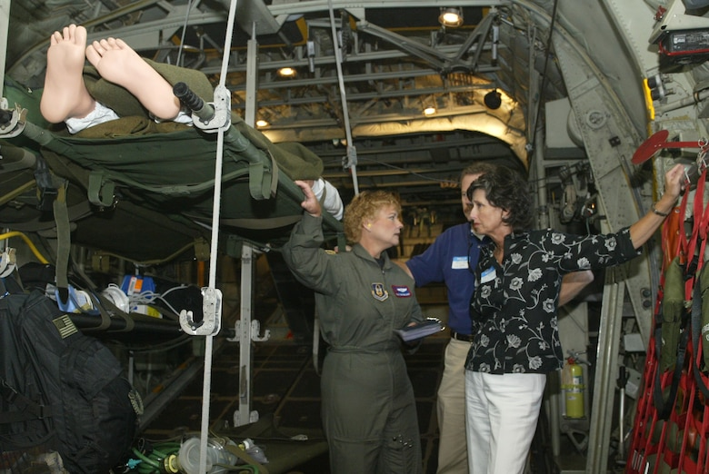Maj. Mary Youngblood, 94th Aeromedical Evacuation Squadron flight nurse, speaks with two visiting employers while in a demonstration flight during Employer's Day.