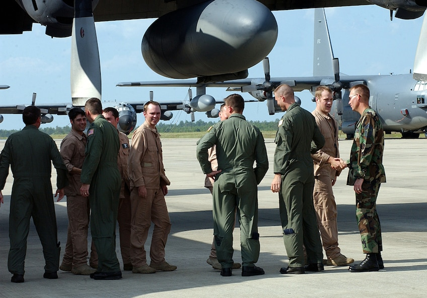 Airmen from the 8th Special Operations Squadron are greeted July 14 as they return from deployment to Southeast Asia.  The returning MC-130E Combat Talon I was the last-ever to be used on an active-duty combat mission. (Air Force Photograph by Senior Airman Jessica Klingler)