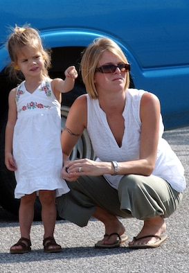 Jordin Pressler (left) and her mother, Laci, wait on the tarmac at Duke Field July 14 as the MC-130E Combat Talon I and Senior Airman Steve Pressler, 8th Special Operations Squadron, return from a deployed location. (Air Force Photograph by Senior Airman Jessica Klingler)