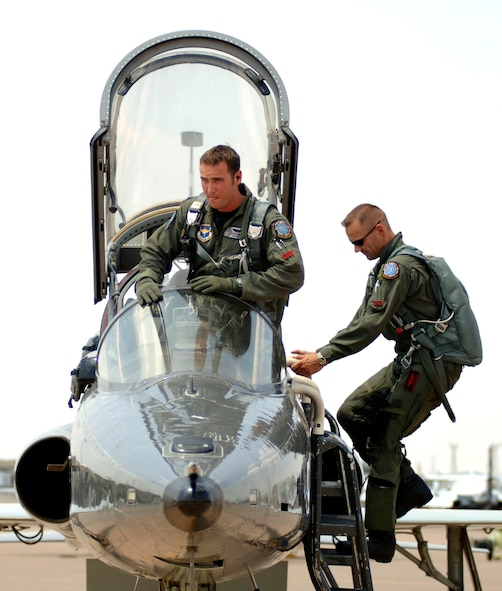 First Lt. Stephen Thomas (left) and Capt. Lars Holten prepare for take-off in a T-38 Talon at Sheppard Air Force Base, Texas. Captain Holten, from Norway, and Lieutenant Thomas are in the Euro-NATO Joint Jet Pilot Training program; the captain is an instructor pilot. (U.S. Air Force photo/Tech. Sgt. Cecilio M. Ricardo Jr.)