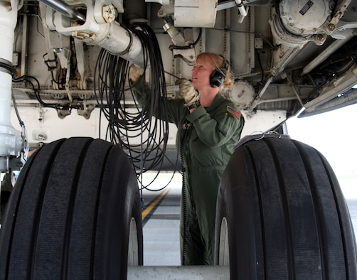 Flight Engineer, Tech. Sgt. Tammy Goble from the 89th Airlift Squadron, prepares a C-5 Galaxy for take-off at Wright-Patterson AFB, Ohio.  It is the first C-5 overseas mission to Ramstien Air Base, Germany for the 89th since the retirement of the C-141 Starlifter this past May.  (U.S. Air Force Reserve photo by Senior Airman Martin Moleski.)