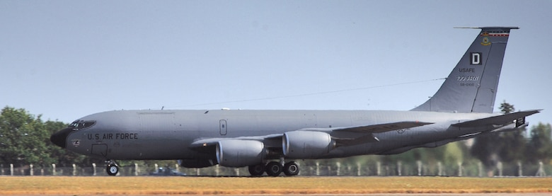 A KC-135 Stratotanker takes off for a mission from Royal Air Force Mildenhall, England, on July 24. Unusually hot weather for this part of England caused a heat wave to distort the lower image of the nearly 50-year-old tanker, just as the heat from the turbofan engines distorts the view of trees behind it. (U.S. Air Force photo/Master Sgt. Lance Cheung)