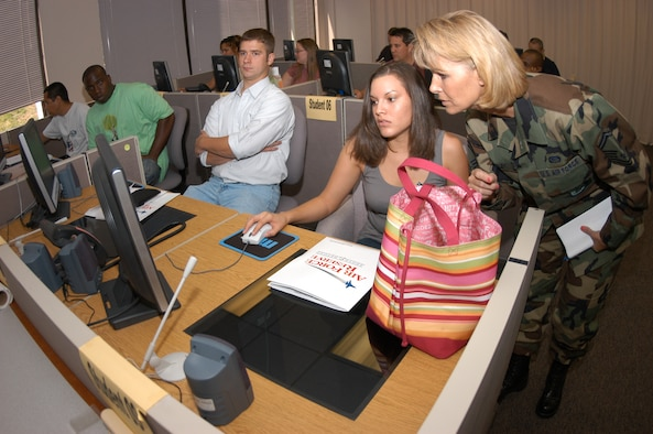 Senior Master Sgt. Janet Riley (right) assists Renee Mariscal as she and other members of the Individual Ready Reserve update their civilian employment information during a muster exercise held at the Air Reserve Personnel Center in Denver July 20, 2006.  IRRs are Air Force members who have served on active duty but still have a military service obligation to the Air Force.  Annually, ARPC orders IRRs to report to an Air Force base, usually within 150 miles of their residence.  Upon arrival, their records are updated, and they receive a basic medical screening and several briefings.  This is a routine process to allow ARPC to look at the activation process, not to initiate activation.  (U.S. Air Force Photo/Cheresa D. Theiral)