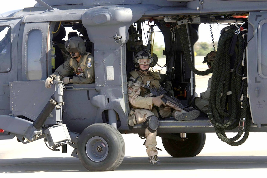 Pararescuemen from the 48th Rescue Squadron sit and await take-off in an HH-60 Pave Hawk from the 305th Rescue Squadron. They were headed to Gila Bend, Ariz., on July 25 for rescue training as part of Exercise Angel Thunder. The five-day exercise, held at Davis-Monthan Air Force Base, Ariz., and other areas is designed to provide realistic combat search and rescue training for active-duty, Reserve and Guard Airmen in combat rescue forces. (U.S. Air Force photo/Senior Airman Christina Ponte)