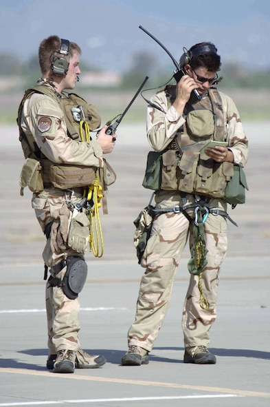 Staff Sgt. Ivan Eggel (right) and Senior Airman Troy Patrick test their radios and equipment before flying to Gila Bend, Ariz., on July 25 for rescue training as part of Exercise Angel Thunder. The five-day exercise, held at Davis-Monthan Air Force Base, Ariz., and other areas is designed to provide realistic combat search and rescue training for active-duty, Reserve and Guard Airmen in combat rescue forces. Sergeant Eggel and Airman Patrick are pararescuemen with the 48th Rescue Squadron, (U.S. Air Force photo/Senior Airman Christina Ponte)