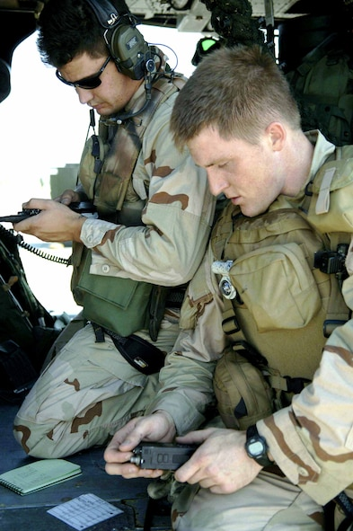 Staff Sgt. Ivan Eggel (left) and Senior Airman Troy Patrick sync their radios before taking off in an HH-60 Pave Hawk from the 305th Rescue Squadron. They were headed to Gila Bend, Ariz., on July 25 for rescue training as part of Exercise Angel Thunder. The five-day exercise, held at Davis-Monthan Air Force Base, Ariz., and other areas is designed to provide realistic combat search and rescue training for active-duty, Reserve and Guard Airmen in combat rescue forces. Sergeant Eggel and Airman Patrick are pararescuemen with the 48th Rescue Squadron. (U.S. Air Force photo/Senior Airman Christina Ponte)