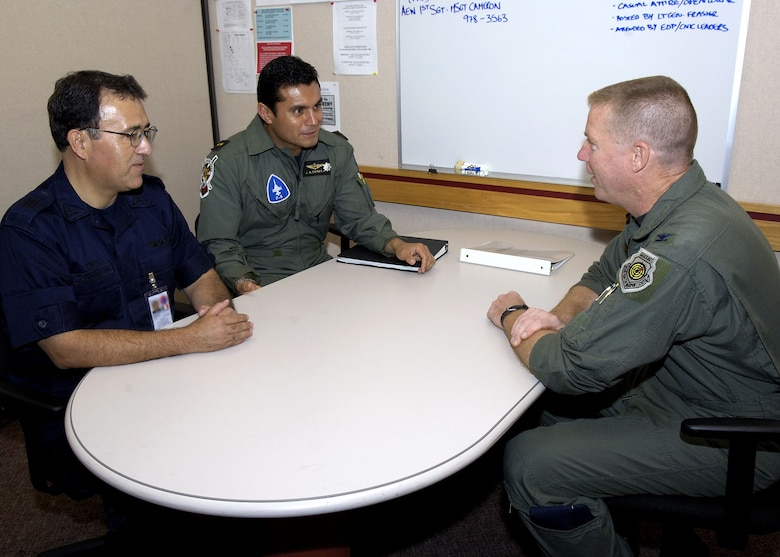 EIELSON AIR FORCE BASE, Alaska - Lieutenant Colonel Jose Antonio Sierra Amador and Captain Gerard de Jesus Navarro Mannon,the Mexican Air Force observers, speak with Colonel Rusty Cabot, Excersise Cooperative Cope Thunder 06-3 (CCT06-3) deployed forces commander. The Mexican Air Force is looking to participate in an exercise like sometime in the future.  Photo by Cpl J.A. Wilson, CCT06-3 Canadian Public Affairs