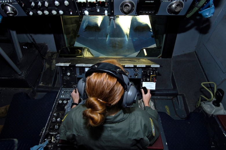 Senior Airman Alicia Trudeau refuels a B-2 Spirit from a KC-10 Extender over Australia during exercise Green Lightning on Tuesday, July 25. The KC-10 and B-2 are from the 36th Expeditionary Wing at Guam. The exercise will test U.S. capabilities and provide operational familiarity in the region for the Pacific bomber presence as well as serve to enhance relations with the Australians. Airman Trudeau is deployed from the 78th Air Refueling Squadron at McGuire Air Force Base, N.J. (U.S. Air Force photo/ Tech. Sgt. Shane A. Cuomo)