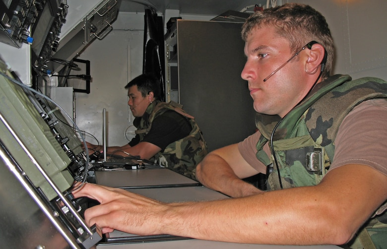 BARBER?S POINT, Hawaii -- Tech. Sgt. Daniel Keefe and Tech. Sgt. William Chang monitor RADAR screens during an exercise at Barber's Point, Hawaii, on 25 July, 2006.  Both Airmen are with the Hawaii Air National Guard's 297th Air Traffic Control Squadron. (US Air Force Photo by Tech. Sgt. Chris Vadnais)