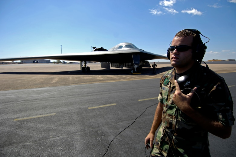 Senior Airman Cory Cahill listens to a B-2 Spirit aircrew during exercise Green Lightning at Royal Australian Air Force Base Darwin on July 27.  The exercise tests U.S. capabilities and provides operational familiarity in the region for the Pacific bomber presence while also serving to enhance relations with the Australians. Airman Cahill is from the 509th Aircraft Maintenance Squadron at Whiteman Air Force Base, Mo.  (U.S. Air Force photo/Tech. Sgt. Shane A. Cuomo)