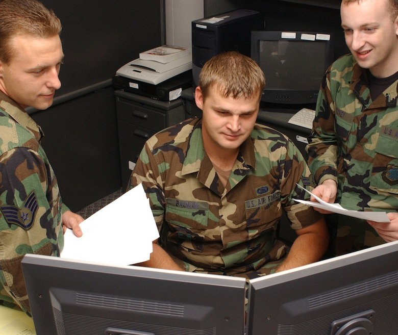 From left, Staff Sgt. Scott Karter and Airmen 1st Class Tom Sirovey and Christopher Bauman, 81st Training Support Squadron, Keesler Air Force Base, Miss., created the Hurricane Katrina Relief Fund database that monitored contributions and tracked applications for assistance. (U.S. Air Force photo by Kemberly Groue)