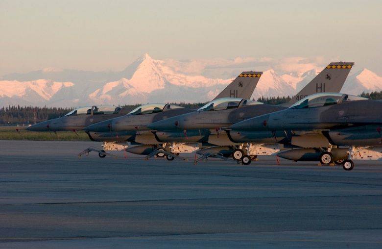 EIELSON AFB, Alaska -- F16 fighter aircaft  from the 419th FW, Hill AFB stand ready against the back drop of Mt McKinley. The F16s are participating in Cooperative Cope Thunder 06-03 held at Eielson AFB, Alaska.  The multi-national exercise is being held from 20 July thru 5 August, 2006  USAF Photo By: SMSgt Jeff Rohloff