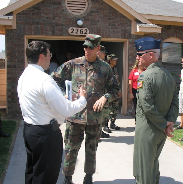 Tim Farmer (left), 27th Civil Engineering Squadron housing officer, discusses base housing with Chief Master Sgt. Todd Small, 16th Special Operations Wing command chief, and Col. Norman Brozenick Jr., 16th SOW commander, at the Cannon Meadows, housing subdivision in neighboring Portales, N.M., during the group's visit.  (U.S. Air Force Photograph by Lt. Amy Cooper)