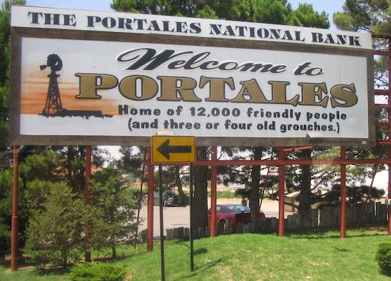 A sign at the edge of the Portales, N.M., city limits welcomes visitors to the town.  With approximately 12,000 residents, Portales is the smaller of the two towns that lie next to Cannon Air Force Base, N.M.  Clovis is the larger of the base's two adjacent cities.  (U.S. Air Force Photograph by Lt. Amy Cooper)