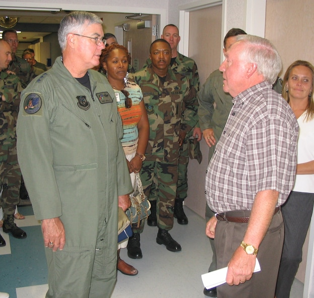 Lt. Gen. Michael Wooley, (left) Air Force Special Operations Command commander, speaks with James D'Agastino, Roosevelt General Hospital chief executive officer administrator, about the services the facility provides to residents during the group's visit to Portales, N.M.  The 12,000-person city is approximately 12 miles from Cannon Air Force Base.  (U.S. Air Force Photograph by Lt. Amy Cooper)