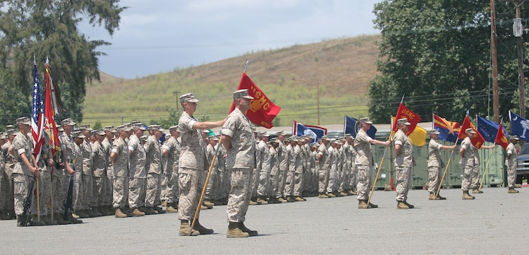Marines from the 3rd Battalion, 1st Marine Regiment, 1st Marine Division, stand in formation awaiting the presentation of the Navy Cross medal to former Marine Sgt. Robert J. Mitchell during a ceremony aboard Camp Pendleton, Calif., July 28, 2006.  Mitchell earned the award for his heroism during the battle for Fallujah, Iraq in November 2004.