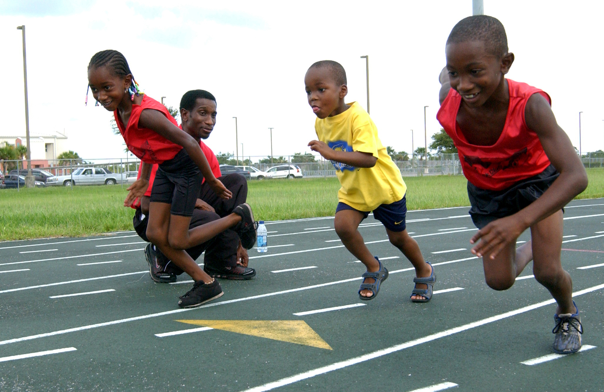 Kids Running Track Track coach has youth running