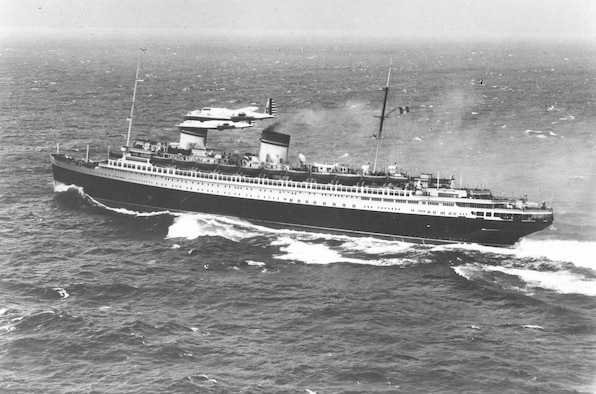 """Boeing Y1B-17 fly-by near the Italian liner """"Rex,"""" about 800 miles east of New York City. (U.S. Air Force photo)"""